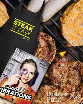 Geschenkbox zum Vatertag mit Fleisch, was zu Lesen und einer hübschen Grillschürze